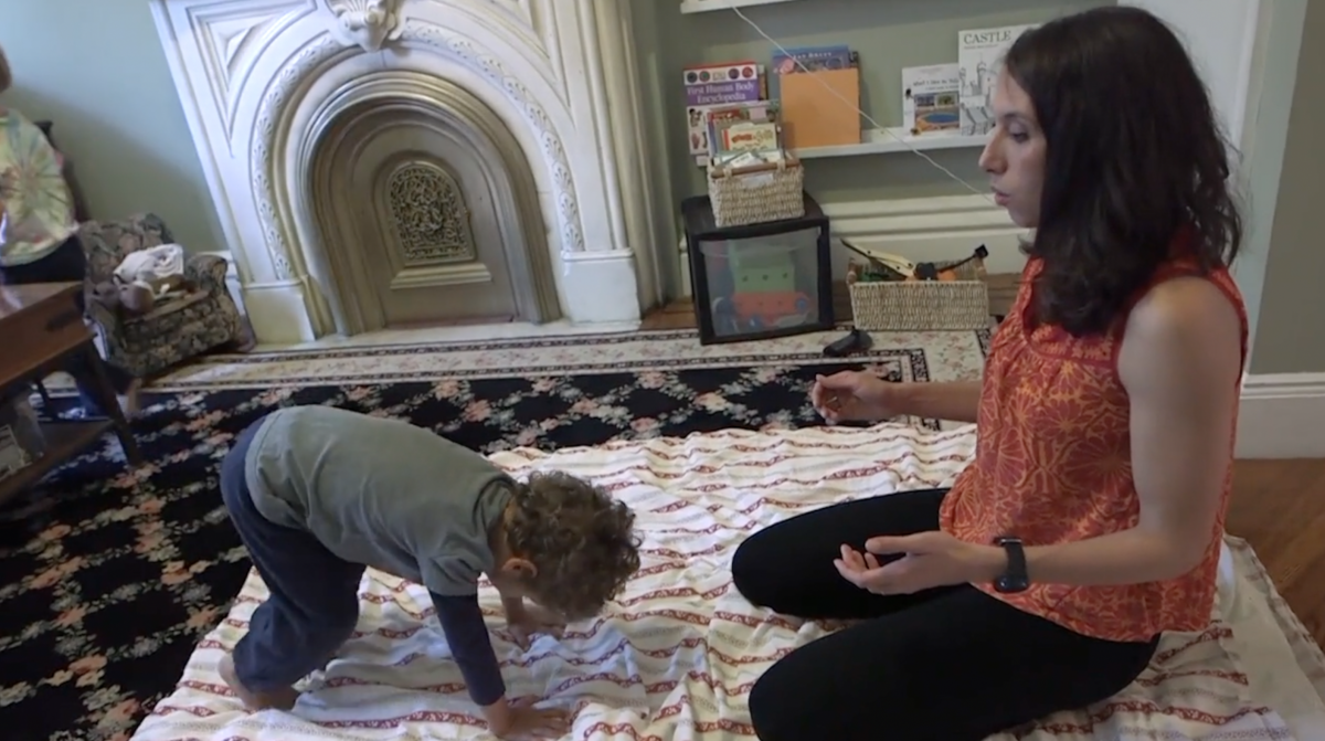 Young boy doing Animal Yoga with Jocelyn teaching