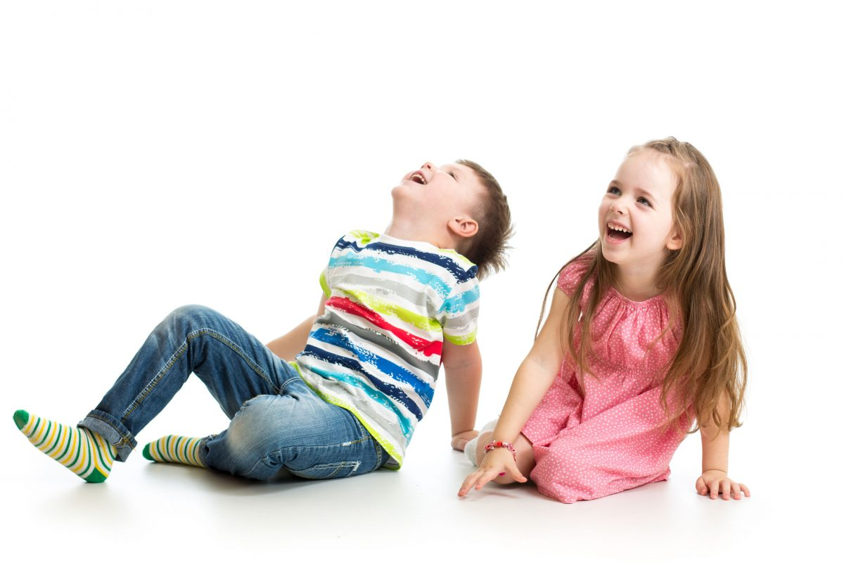 boy and girl laughing on floor