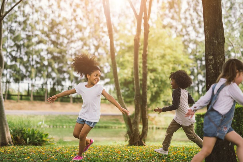 playing kids outside and socially distanced