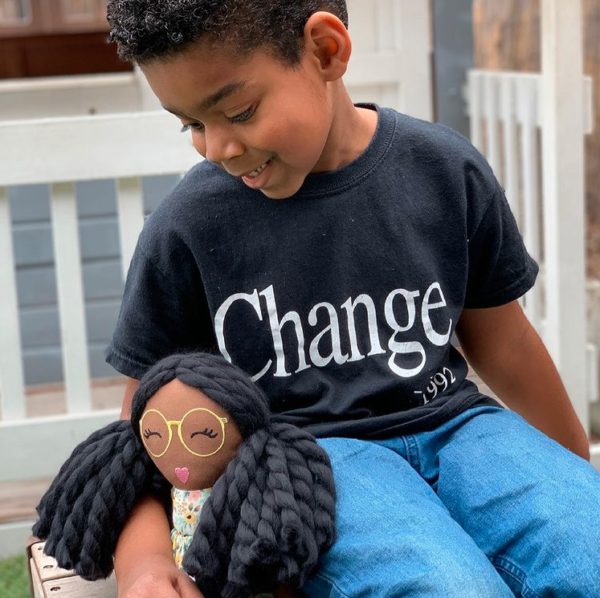 boy with modern doll studio doll and change shirt